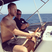Image 6: Calvin Harris driving a boat