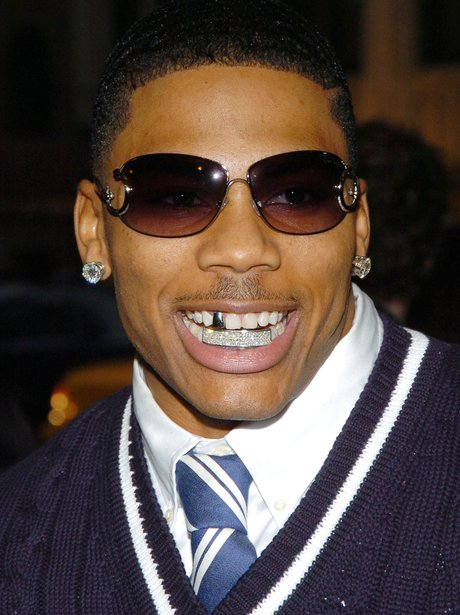 Nelly wearing Teeth Grillz