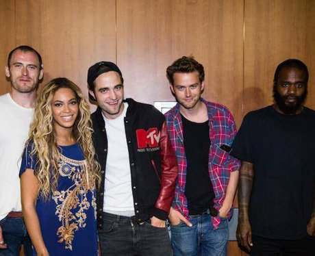 Beyonce and Robert Pattinson posing with Death Grips