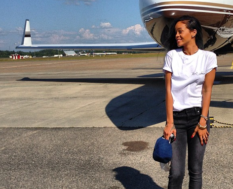 Rihanna poses outside of her private jet