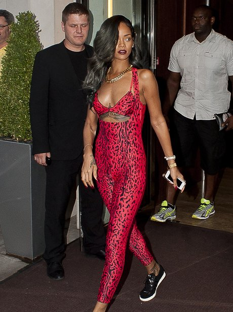 Rihanna wearing a tight leopard jumpsuit in red