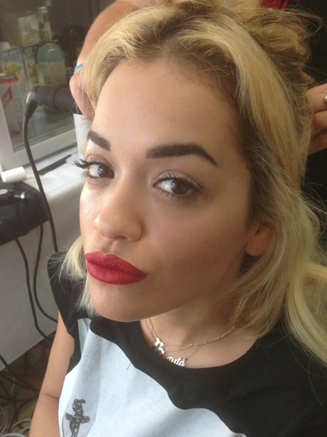 Rita Ora shows off her red pout