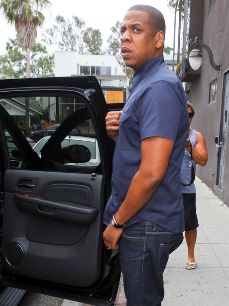 Jay Z getting into a black car after visiting North West