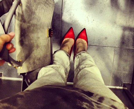 Jessie J in an elevator with red shoes