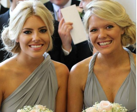Mollie King and her sister wearing bridesmaid dress