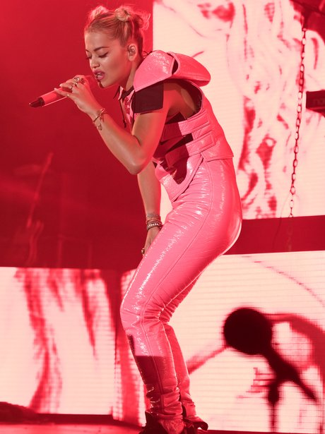 Rita Ora wearing pink leather jumpsuit at Global Gathering festival in Stratford