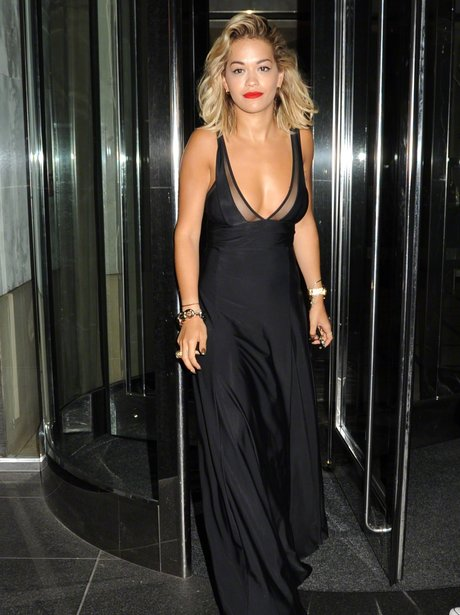 Rita Ora removes her bra seen here leaving hotel