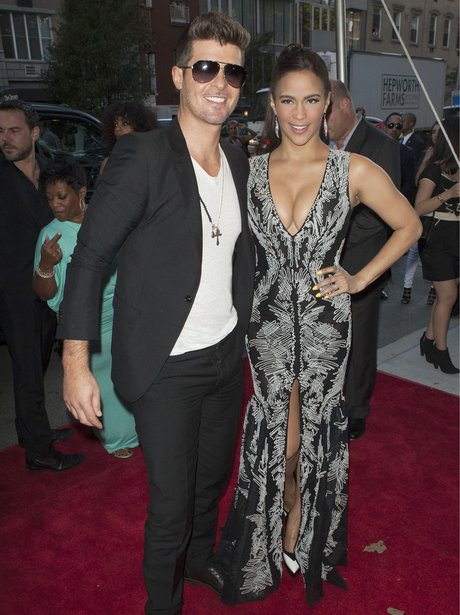 Robin Thicke and Paula Patton holding hands on red carpet at 2 Guns premiere