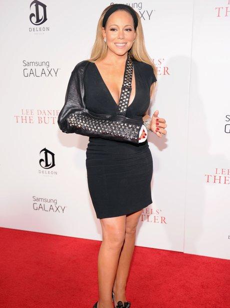 Mariah Carey wearing a sling