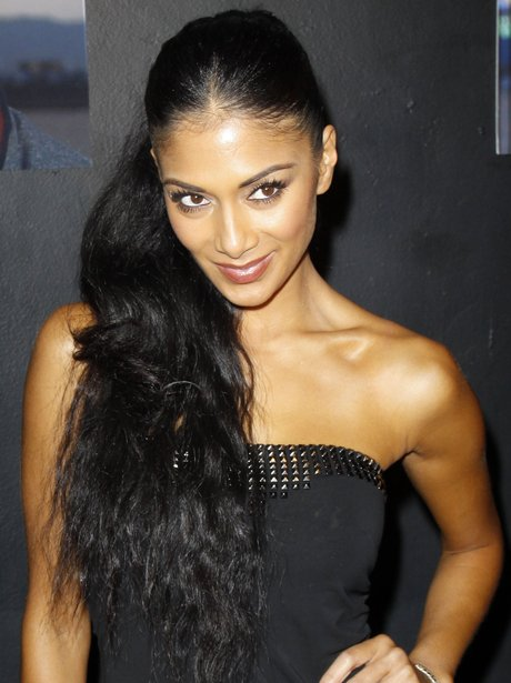 Nicole Scherzinger with her black hair tied back