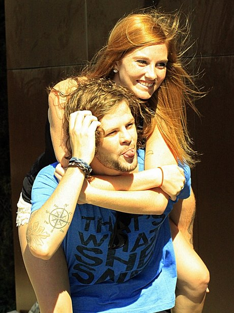 Jay McGuiness gives a fan a piggy back