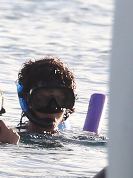 Rihanna snorkeling out in Barbados