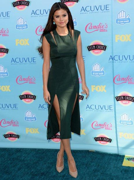 Selena Gomez wearing emerald green dress at Teen Choice Awards 2013