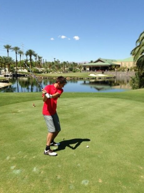 Tom Parker playing golf