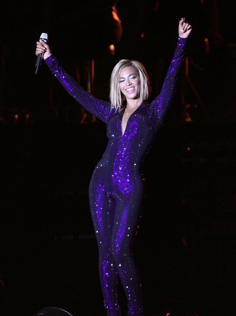 Beyonce at V Festival wearing a blue catsuit
