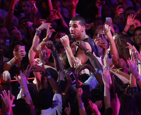 Drake surrounded by fans