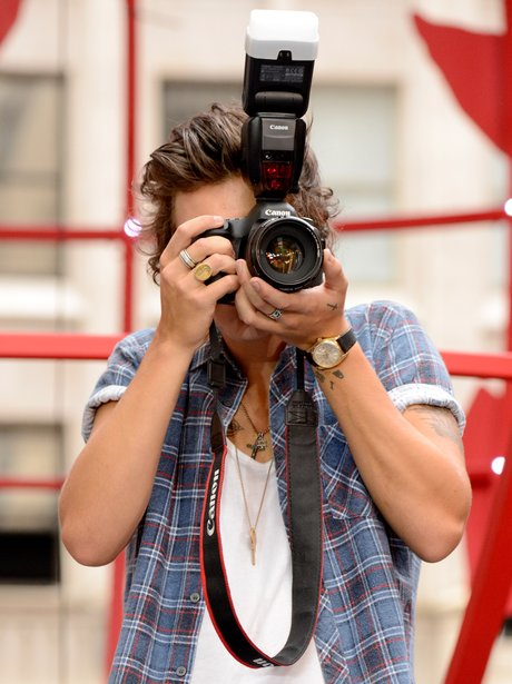 Harry Styles taking a picture