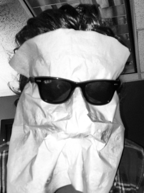 Harry Styles with a napkin on his face