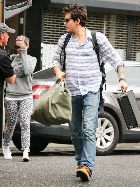 Katy Perry and John Mayer wearing a 'Roar' sweatshirt jumper