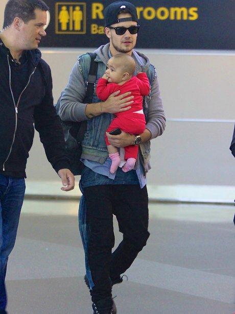 Lady Payne holding a baby