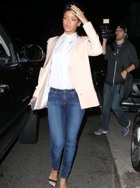 Rihanna wearing a pink blazer and jeans
