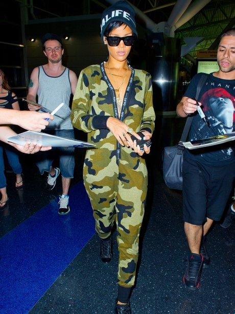 Rihanna wearing a camo jumpsuit