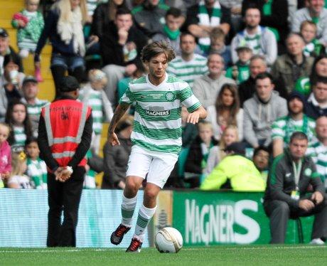 Louis Tomlinson playing football