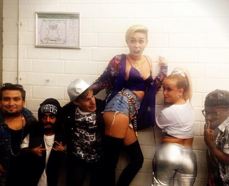 Miley Cyrus poses backstage before her Alan Carr performance