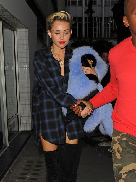 Miley Cyrus leaving her hotel in London