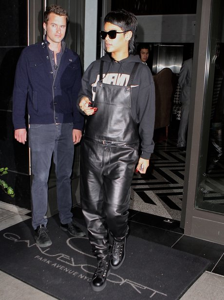Rihanna wearing leather dungarees