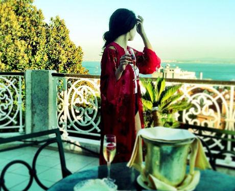 Selena Gomez surveys her balcony in Lisbon in Portugal