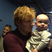 Image 9: Ed Sheeran holds up a baby