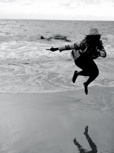 Beyonce jumping on the beach
