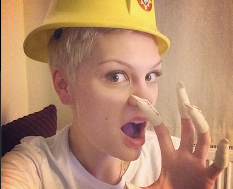 Jessie J wearing a hard hat