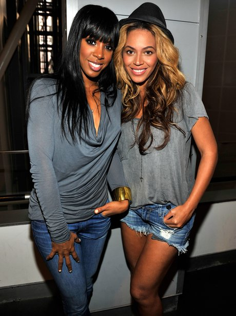 Kelly Rowland and Beyonce posing together in 2011