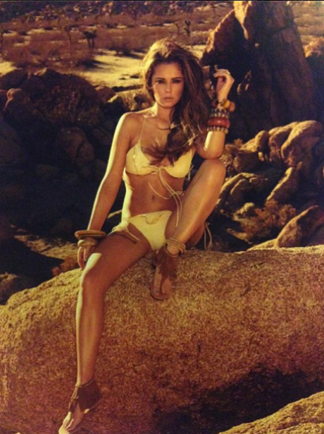 Cheryl Cole dressed like a cavegirl