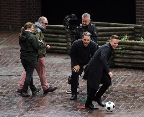 Olly Murs and Robbie Williams on the video set