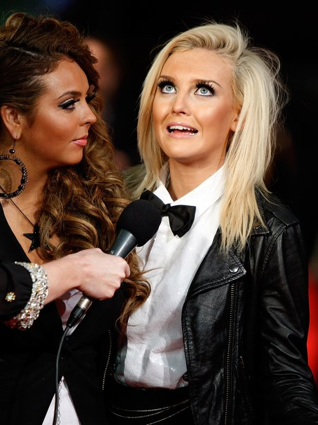 Perrie Edwards gets interviewed by her bandmate