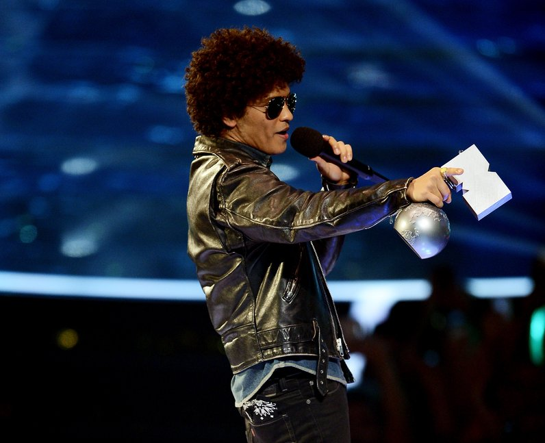 Bruno Mars accepts the 'Best Song' award at the MT