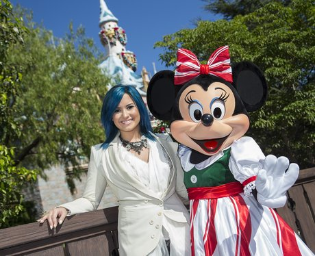 Demi Lovato poses with Minnie Mouse