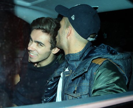 Max George kissing Nathan on the cheek