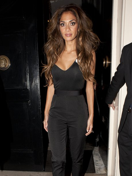 Nicole Scherzinger wearing a black playsuit