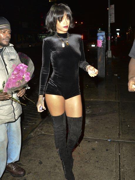 Rihanna wearing a black body suit
