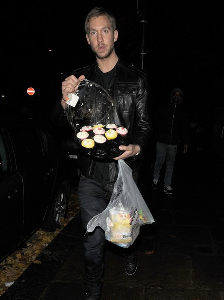 Calvin Harris holding cakes