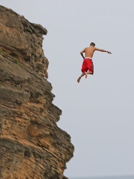 Justin Bieber jumping off a cliff