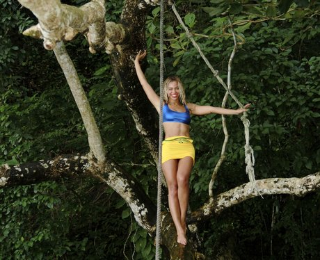 Beyonce climbing a tree on holiday
