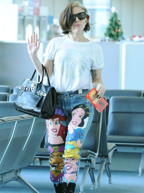 Lady Gaga wearing jeans with Disney characters