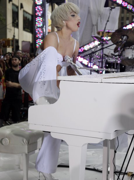 Lady Gaga playing the piano in concert