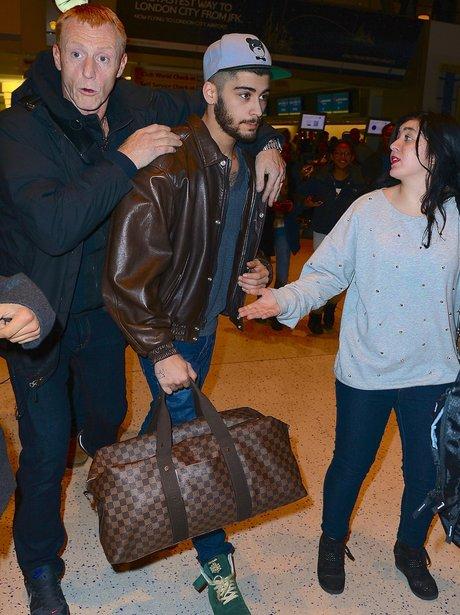Zayn Malik at the airport heading to New York