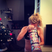 Image 8: Ellie Goulding holding up a giant Christmas cracker